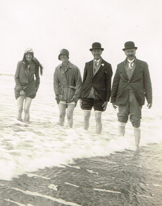 four people paddling in the sea in 1930/31