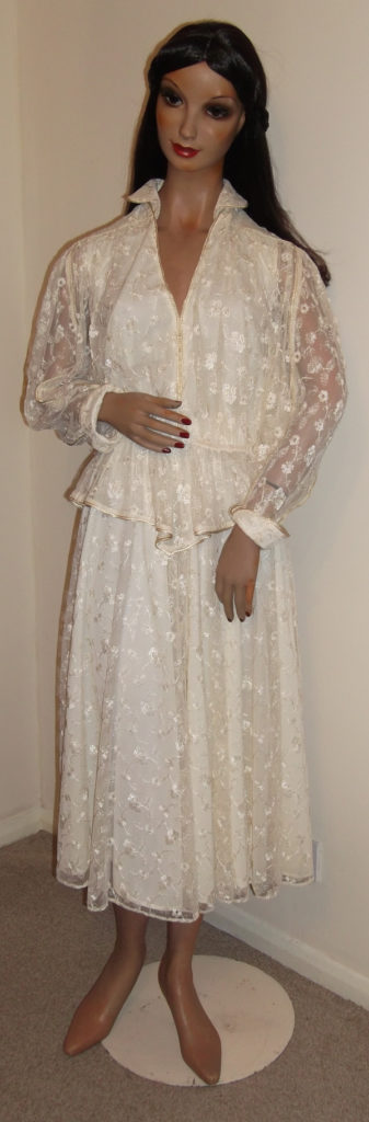 1970s cream lace skirt suit on mannequin - front view