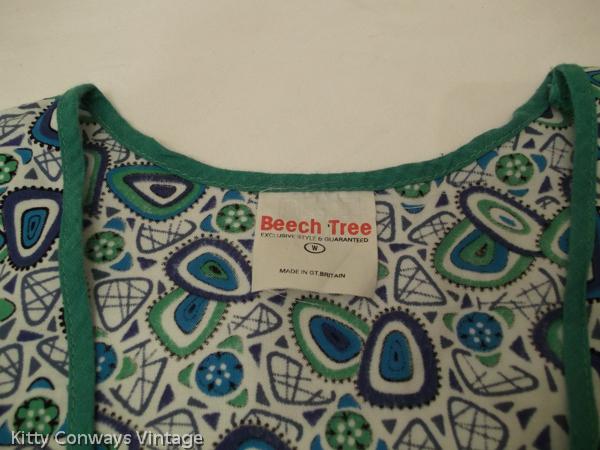 1960s blue green patterned apron - label - Beech Tree