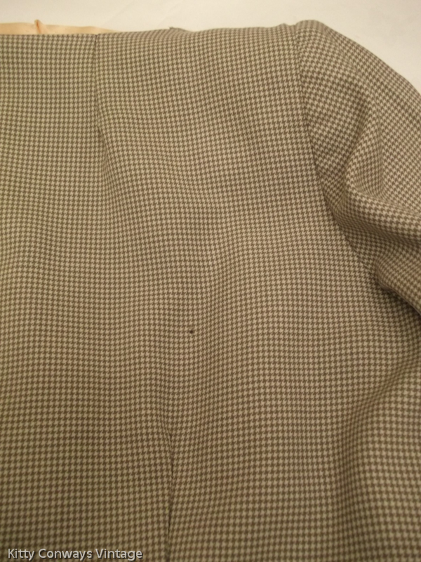 1950s/60s dress suit - close up of hole/damage