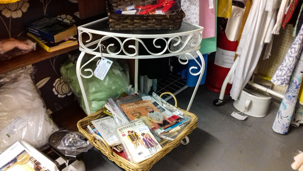 Bygone Times - Kitty Conways stall - dress patterns and wrought iron hall table