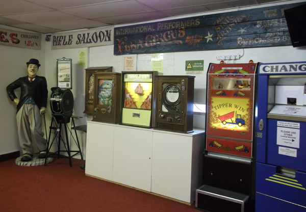 Bygone Times Vintage Arcade - slot and change machines and Charlie Chaplin
