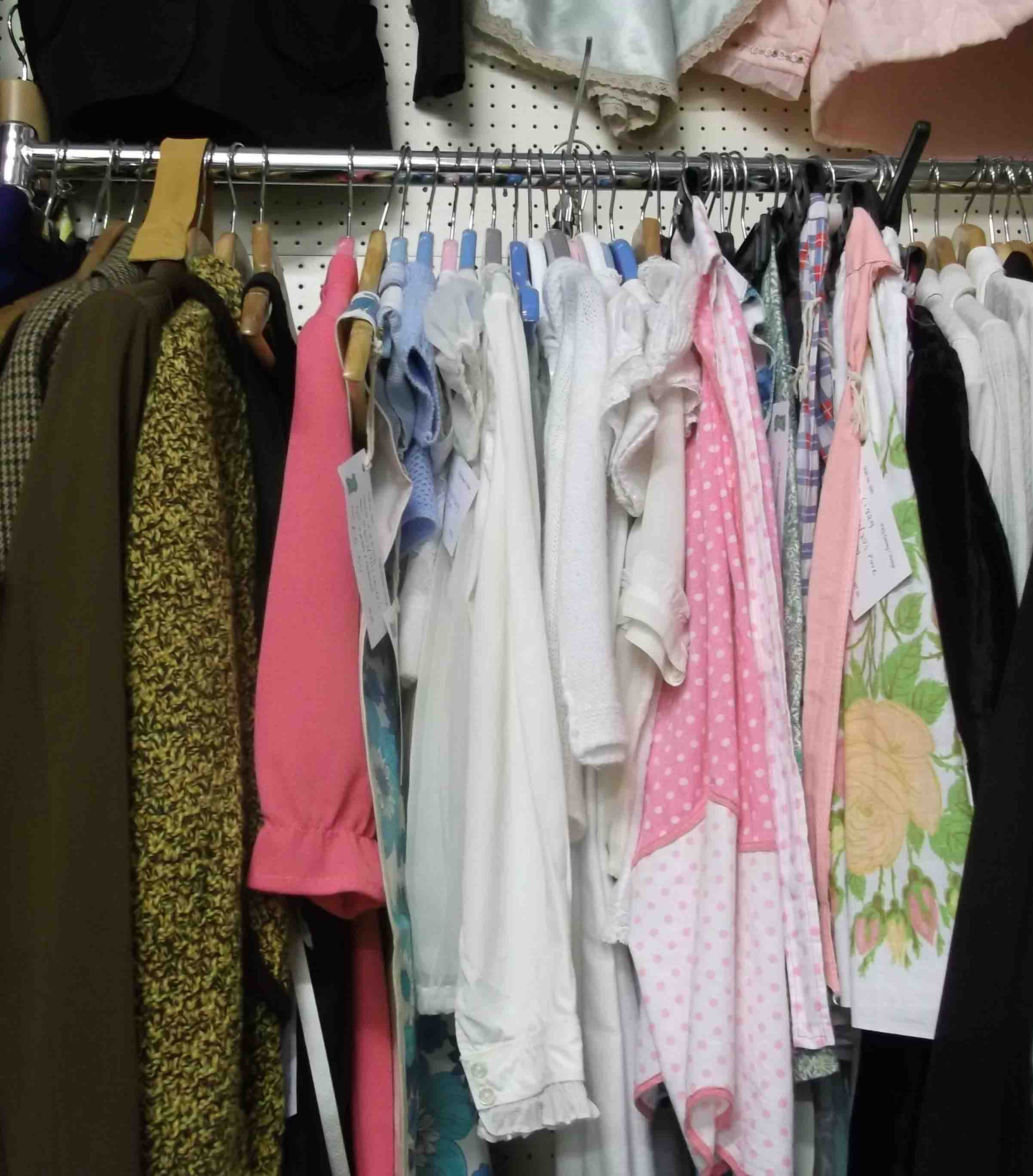 Close up of the rail of vintage clothes on stall 590. Includes wool suits and pinnies