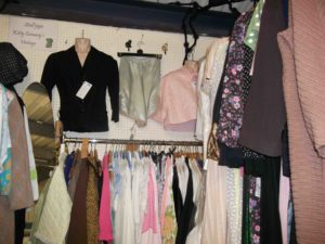 Far end of Kitty conway's stall with new stock including baby blue 1940s rayon and lace knickers and a 1940s black jacket.