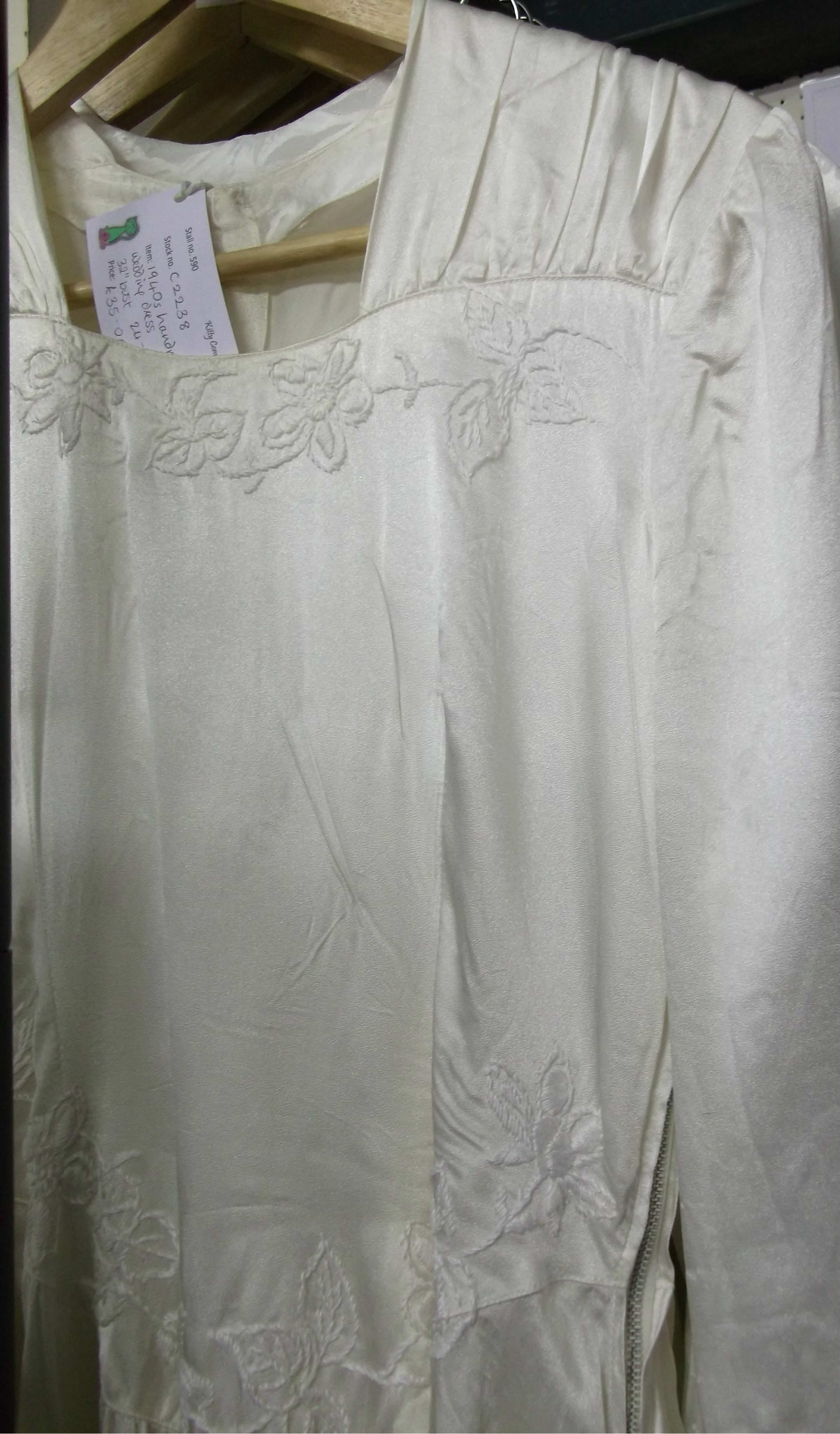 Embroidered flowers on off white faux silk wartime weddingdress