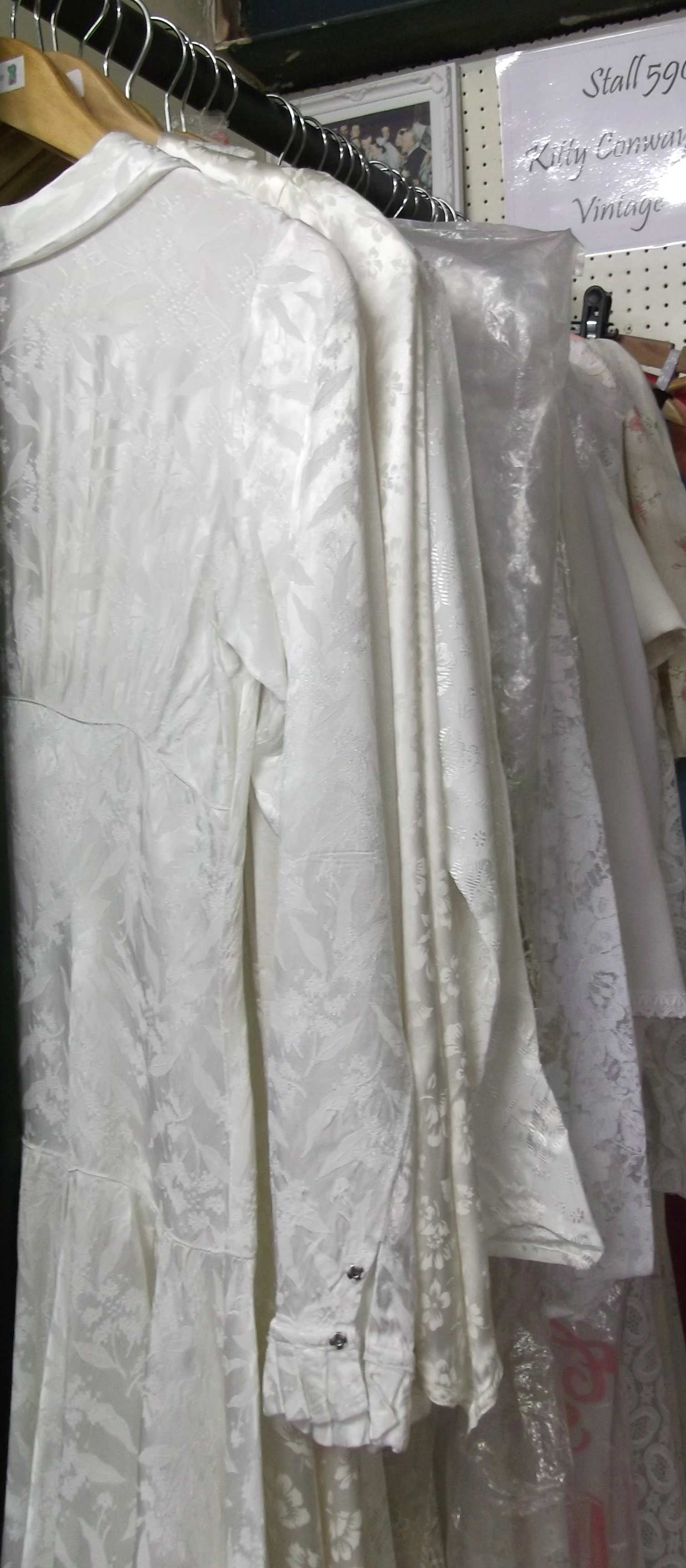 Close up of selection of 1930s to 1940s wedding dresses