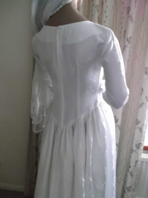 View of the back top half of the wedding dress