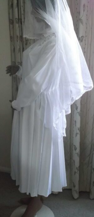 Side view of the dress without belt showing the three quarter length