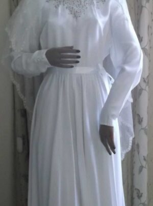 Front full view of dress - mannequin wears a veil