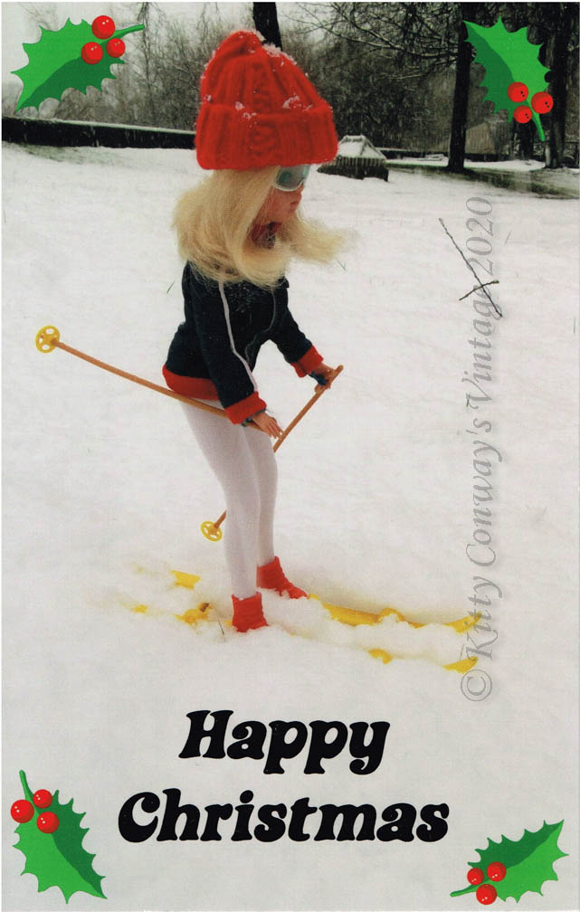 Blonde Sindy in her wooly hat and anorak skis through heavy snow